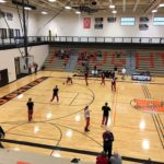 The Gremlins warm up on their home court where they hosted the Redettes tonight.