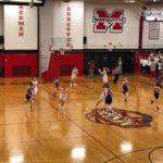 The Redettes drive down the court.
