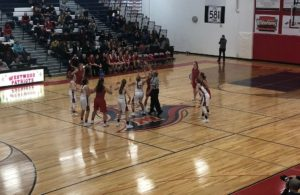 The Redettes go for the jump ball!
