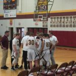The Maroons huddle up.