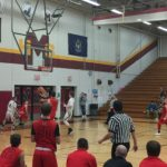 The Redmen go for the lay-up.