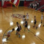 A Redmen drives to the hoop.