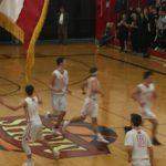 The Marquette Redmen hustle down the court to prepare on defense