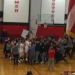 Fans, players, parents, and coaches all celebrate together