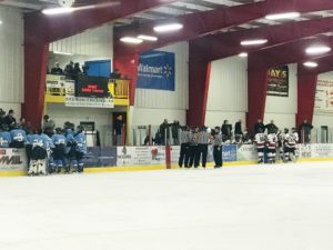 Teams confer with their coaches