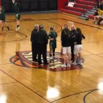 Opponents shake hands before the District Championships.
