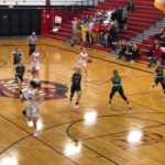 The Redettes make a drive to the basket.