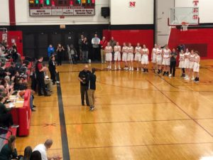 The Redettes and Coach Ben Smith accept the District Championship trophy!