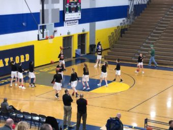 The Redettes get ready for their game against Midland Dow.