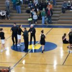 Opponents take center court before tip off.
