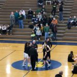 Opponents shake hands before a tough match-up between the Marquette Redettes and the Midland Dow Chargers in the MHSAA Regional Semifinal.