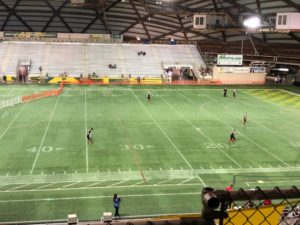 Outfielders prepare for the game in the Superior Dome