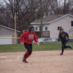 Maya King rushes to third base