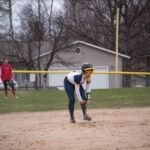 A Negaunee runner rests at second base between plays