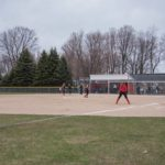 The Negaunee Miners take the plate at their home field