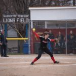 Amanda McIntire winds-up to send the ball to the catcher