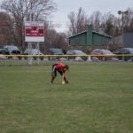 The Redettes field a ball hit to the left side