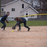 The Negaunee Miners' short stop fields a ball