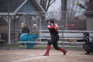 A Redettes batter takes a cut at the ball