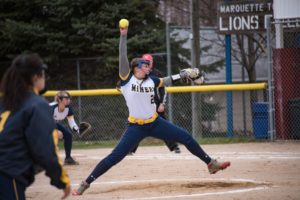 Negaunee prepares to send the ball over home plate