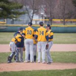 The Negaunee Miners take a break at the mound to focus their defense
