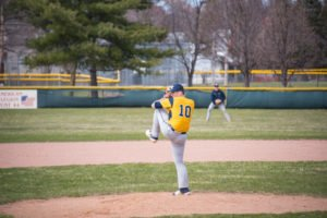 The Negaunee Miners' pitcher winds-up to deliver to the plate