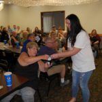 Amy delivering a door prize to a guest.