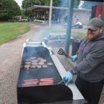 Grillin up some burgers and brats at the Grab-n-Go station.