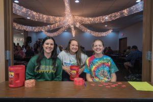 Abbie, Amy, and Madison getting everyone checked in!