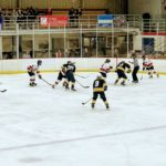 A defensive zone faceoff for the Redmen