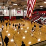 Marquette and Traverse City Central warming up before the District Title game