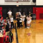 The Redettes during a timeout getting instructions from head coach Ben Smith