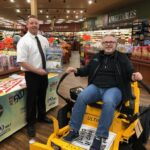 Mike and Chuck at Super One Foods in Marquette with the Ultima ZT1 Riding Mower